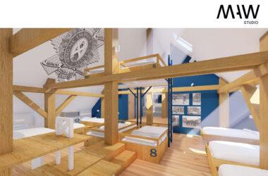 Duża wysoka sypialnia z wieloma drewnianymi łóżkami